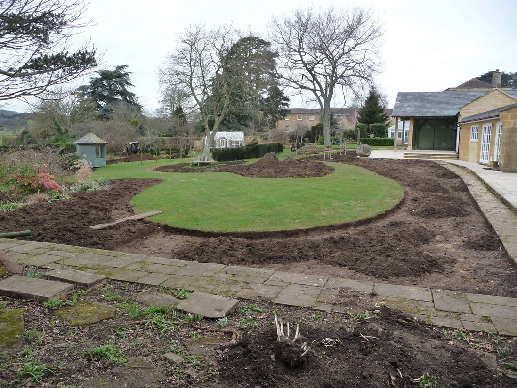 a new curved lawn shaped from the old lawn in Somerset